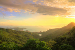Beautiful sunset over the mountain. Nice and warm beautiful sunset from mountain view at Hong Kong (HDR Royalty Free Stock Image