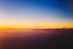 Beautiful sunset over mountains from height of airplane Royalty Free Stock Images