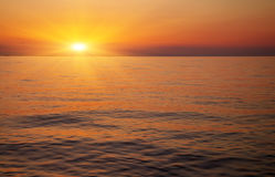 Beautiful sunset over the ocean. Sunrise in the sea Stock Images