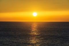Beautiful sunset over the ocean. Sunrise in the sea Stock Photos