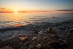 Beautiful sunset over the ocean. Sunrise in the sea Royalty Free Stock Photo