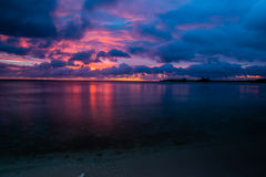 Beautiful sunset over ocean water. Taken from a beach in Guam Royalty Free Stock Photo