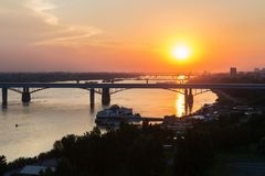 Beautiful sunset over the Octyabrsky bridge across river Ob in Novosibirsk. Beautiful sunset over the Octyabrsky bridge across the river Ob in Novosibirsk Royalty Free Stock Image