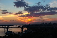 Beautiful sunset over the Octyabrsky bridge across river Ob in Novosibirsk Royalty Free Stock Image