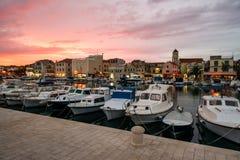 Beautiful sunset over old croatian town Stock Photos