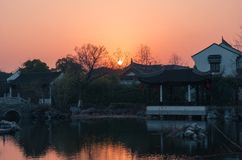 Sunset over old hystorical chinese town, traitional asian houses in watertown. Beautiful sunset over old hystorical chinese town royalty free stock images