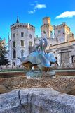 Beautiful sunset over old Swans fountain by Hluboka nad Vltavou chateau. Hluboka Castle, Czech Republic.  stock photography