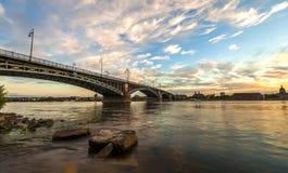 Beautiful sunset over Rhine / Rhein river and old bridge in Main Stock Photo