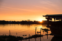 Beautiful sunset over the river and home Stock Images