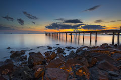 Beautiful sunset over rocky beach Royalty Free Stock Images