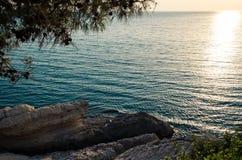 Beautiful sunset over rocky sea coast. Of Ulcinj, Montenegro Stock Images
