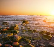 Beautiful sunset over rocky seashore Royalty Free Stock Images