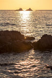 Beautiful sunset over the rocky seashore Stock Image