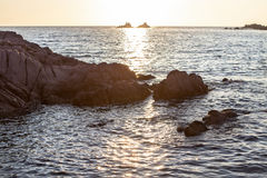 Beautiful sunset over the rocky seashore Stock Images