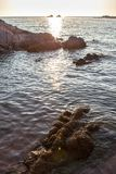 Beautiful sunset over the rocky seashore Stock Photo