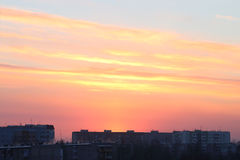 Beautiful sunset over roofs of residential buildings Stock Images