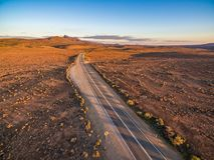 Sunset over rural highway passing through South Australian desert. royalty free stock images