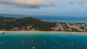 Beautiful sunset over sea, aerial view. Boracay island Philippines. Aerial view: Sunset over the sea in the background boats,sailing boat, orange sky and stock video footage