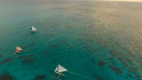Beautiful sunset over sea, aerial view. Boracay island Philippines. Aerial view: Sunset over the sea in the background boats,sailing boat, orange sky and stock video