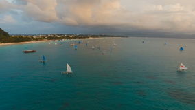 Beautiful sunset over sea, aerial view. Boracay island Philippines. Aerial view: Sunset over the sea in the background boats,sailing boat, orange sky and stock footage