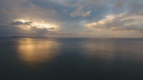 Beautiful sunset over sea, aerial view.Catanduanes. Sunset over the sea. Aerial view: Sunset over the sea in the background orange sky and islands. Fly over the stock video footage