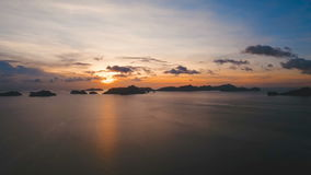 Beautiful sunset over sea, aerial view. Marine tropical sunset over the sea. Aerial view: Sunset over the sea in the background orange sky and islands. Fly over stock footage