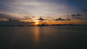 Beautiful sunset over sea, aerial view. stock footage