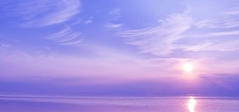 Beautiful sunset over the sea of blue and violet colors.  royalty free stock photo