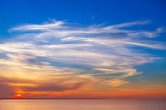 Beautiful sunset over the sea with Cirrus clouds. Beautiful sunset over the sea with Cirrus clouds Stock Image