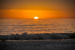 Beautiful sunset over the sea with clear sky in Anna Maria Island, Florida. A very romantic shoreside sunset with orange and blue cloudy sky in Anna Maria Key royalty free stock images