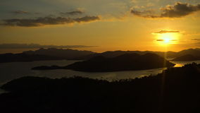 Beautiful sunset over sea. Coron, Palawan, Philippines. Marine tropical sunset over the sea, tropical island, sea bay and lagoon, mountains. Sunset over the sea stock footage