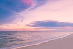 Beautiful sunset over the sea with dramatic clouds Stock Image