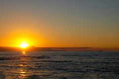 Beautiful sunset over the sea with an endless horizon and a lone. Good mood and excellent well-being, all this gives us a magnificent sea views at sunset. We all royalty free stock photos