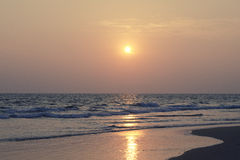 Beautiful sunset over the sea. Image shows the sun setting over the Arabian sea Royalty Free Stock Photo