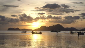 Beautiful sunset over sea. Marine tropical sunset over the sea. Sunset over the sea in the background boats, orange sky and islands. Travel concept. Nothing but stock video footage