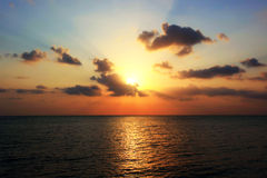 Beautiful sunset over sea with reflection in water Royalty Free Stock Image