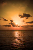 Beautiful sunset over sea with reflection in water Stock Images