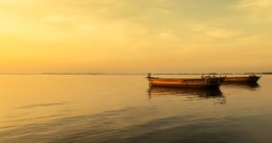Beautiful Sunset over The Sea with Two Big Boats Floating Royalty Free Stock Photography