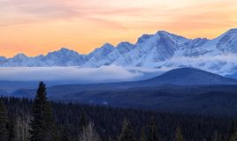 A beautiful sunset over snow covered mountains in Kananaskis in the Canadian Rocky Mountains, Alberta. Canada royalty free stock photography