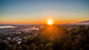 Beautiful sunset over the Sukhum. Evening city and bright sunset Stock Images