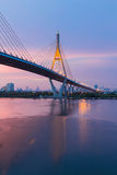 Beautiful sunset over Suspension Bridge cross Bangkok main river, Thailand Royalty Free Stock Photo