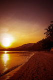 Beautiful sunset over the tropical beach Royalty Free Stock Photos