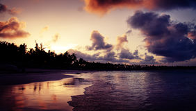 Beautiful sunset over the tropical beach in Punta Cana, Dominica Royalty Free Stock Photos