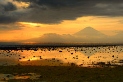 Beautiful sunset over the volcano Agung, Bali by Trawangan islan Stock Image