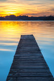 Beautiful Sunset over Wooden Jetty in Groningen, Netherlands Royalty Free Stock Image