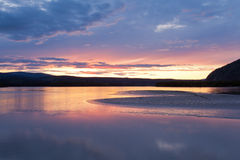 Beautiful sunset over Yukon River near Dawson City Royalty Free Stock Images