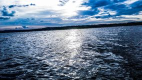 Beautiful sunset of the Paraná River. You can achieve a beautiful view if you decide to get close enough to the water to take a picture. One afternoon of riding Royalty Free Stock Photo