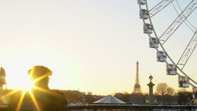 Beautiful sunset in Paris France, tourists watching Big Wheel and Eiffel Tower