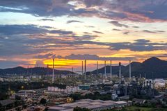 Beautiful sunset petrochemical oil refinery factory plant cityscape royalty free stock photography