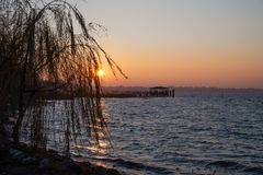 Beautiful sunset on the pier of the abandoned lake. stock photos